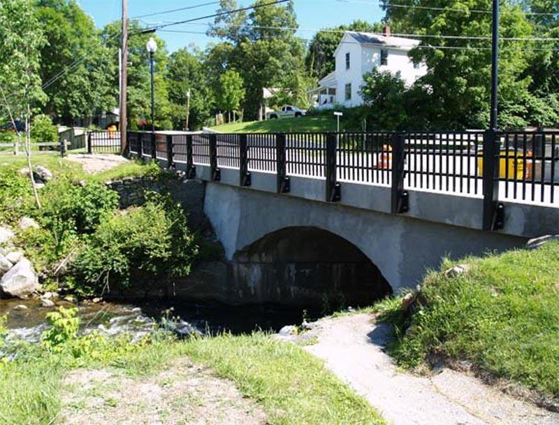 new bridge rail, rail attachment to the bridge