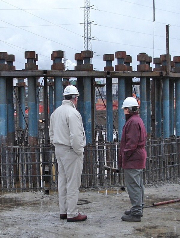 mechanical process engineers stand beside foundation anchorage system