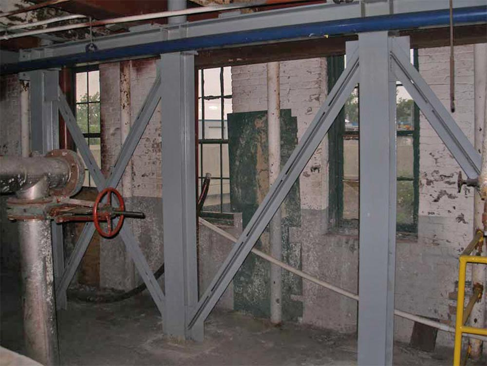 tructural strengthening and load transfer of an existing 80 year old three story industrial building